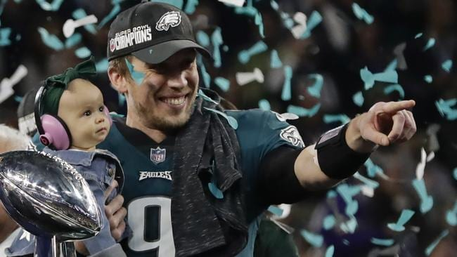 Philadelphia Eagles quarterback Nick Foles holds his daughter after winning Super  Bowl 52. Picture  7144caa54