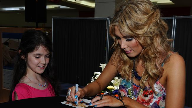 Sign of the times ... Delta Goodrem signs a CD for Sharnay Stavrow of Mt Louisa.