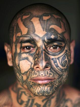 'Psycho', 23, is covered in gang tattoos. Picture: Rodrigo Abd/AFP