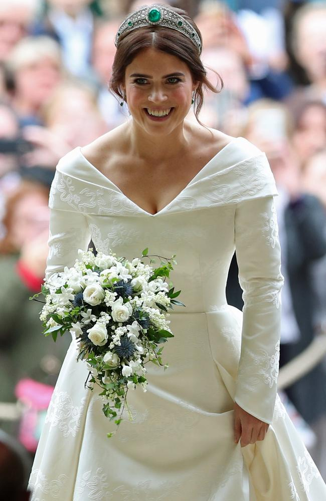 e8139c5c911c Britain's Princess Eugenie of York (walks up the aisle during her wedding  ceremony to Jack