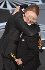 "Kobe Bryant embraces Glen Keane as they accept the award for best animated short for ""Dear Basketball"" during the 90th Annual Academy Awards on March 4, 2018 in Hollywood, California. Picture: AP"