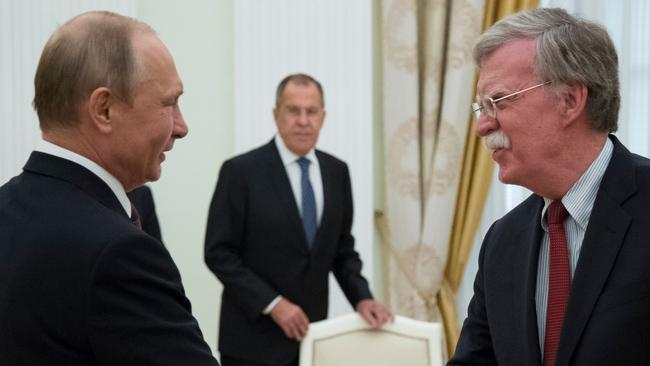 Russian President Vladimir Putin shakes hands with Bolton during the meeting in the Kremlin in 2018.