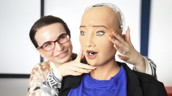 Anna Trikoulis pictured with Sophia, the world's most advanced humanoid robot, at UNSW CBD campus. Picture: Dylan Robinson