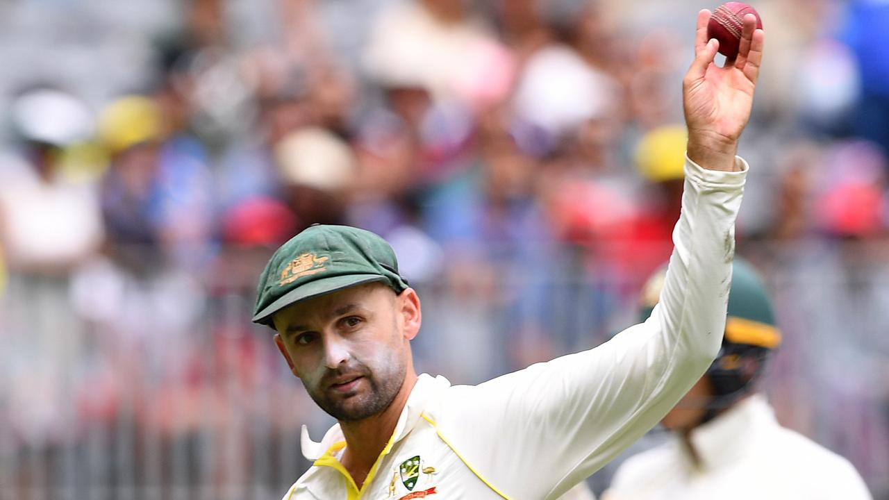 Australian bowler Nathan Lyon shows the ball after taking 5 wickets. Picture: AAP