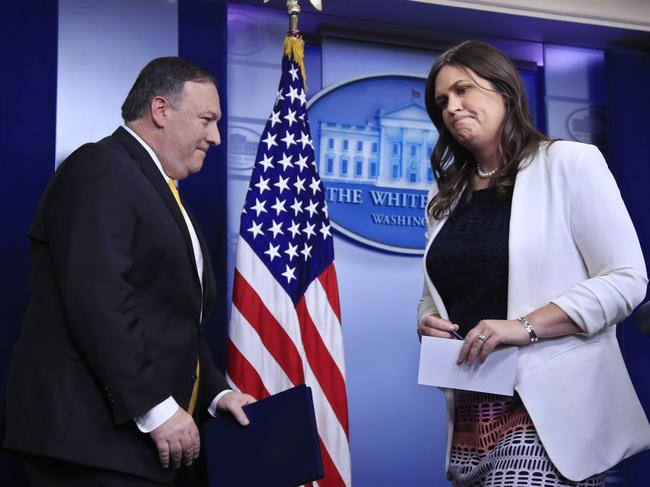 White House press secretary Sarah Huckabee Sanders turns over the podium to Secretary of State Mike Pompeo. Picture: AP