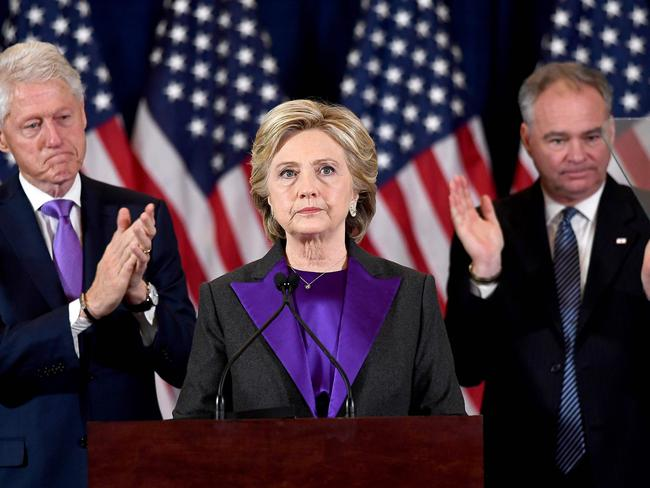 US Democratic presidential candidate Hillary Clinton makes a concession speech as her running-mate Tim Kaine and former president Bill Clinton look on. Picture: Jewel Samad/AFP