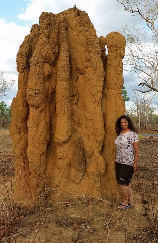 Widely travelled in Australia and overseas, Lily Pereg stands by an ant hill in the Outback.