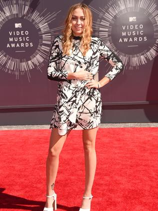 Miley Cyrus' older sister Brandi Cyrus attends the 2014 MTV Video Music Awards.