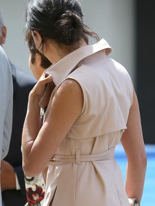 Meghan Markle's blush dress was accessorised with matching clutch and heels.