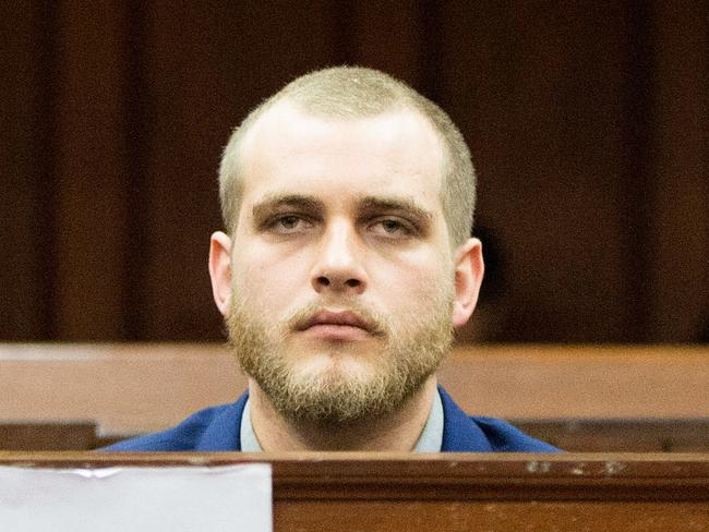 Henri van Breda, 23, was expressionlesss as he was found guilty of killing his wealthy parents and his brother in a frenzied axe attack that also left his sister severely injured. Picture: AFP Photo / Rodger Bosch