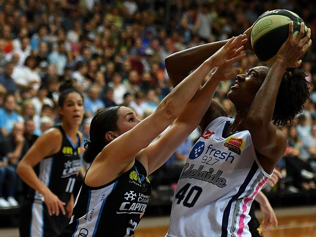 Adelaide Lightning's Kayla Alexander shoots the ball against the UC Capitals during game one of the WNBL grand final series. Picture: AAP / Sam Mooy
