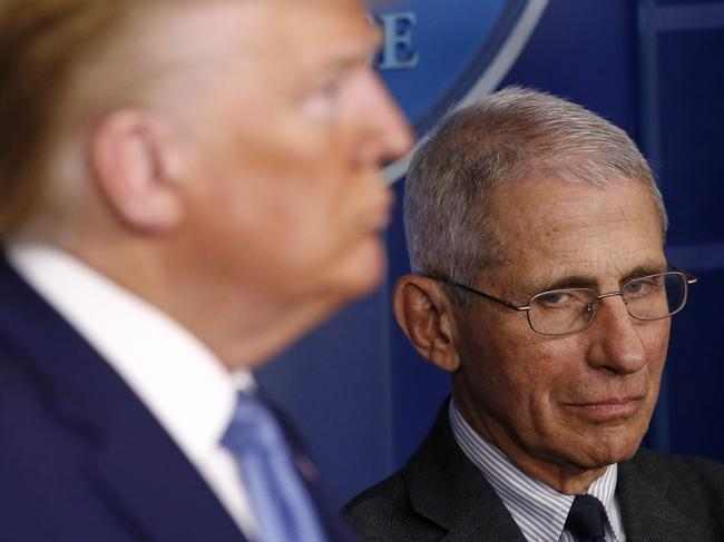 Director of the National Institute of Allergy and Infectious Diseases Dr Anthony Fauci and President Donald Trump. Picture: AP
