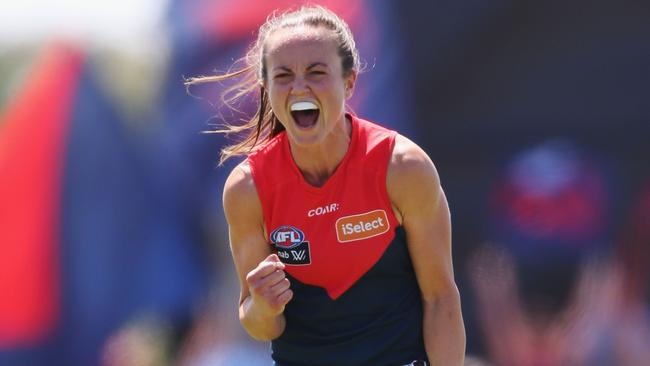 Daisy Pearce of the Demons celebrates the win.