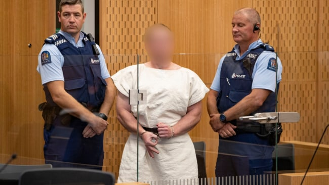 The man charged in relation to the Christchurch massacre, Brenton Tarrant, gestures the 'White Power' symbol in the dock. Image: Getty