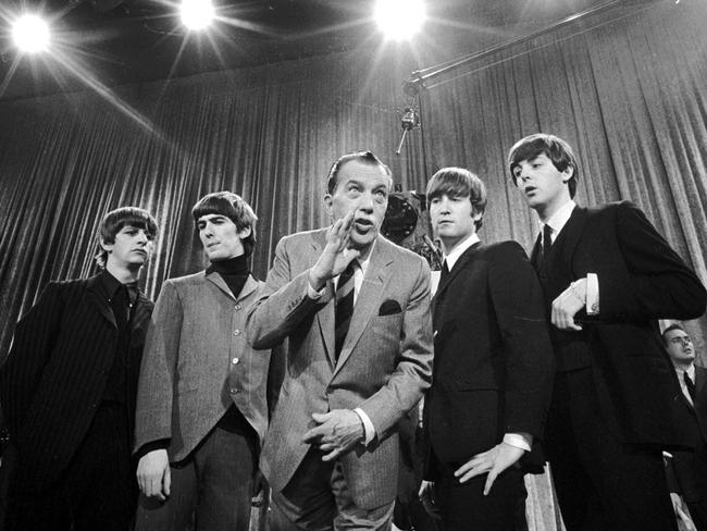 Ed Sullivan (c) stands with The Beatles during a rehearsal in 1964.
