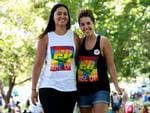 Tanika Robertson (L) and Hayley Willis, who gathered with other Marriage Equality supporters at Prince Alfred Park in Surry Hills, were happy with the Yes result. Picture: Toby Zerna