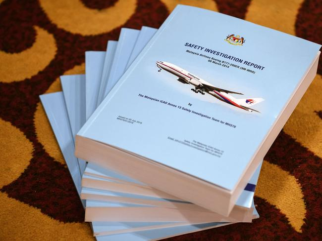 Copies of the MH370 safety investigations report are seen on the floor during a media briefing in Putrajaya, outside Kuala Lumpur. Picture: AFP