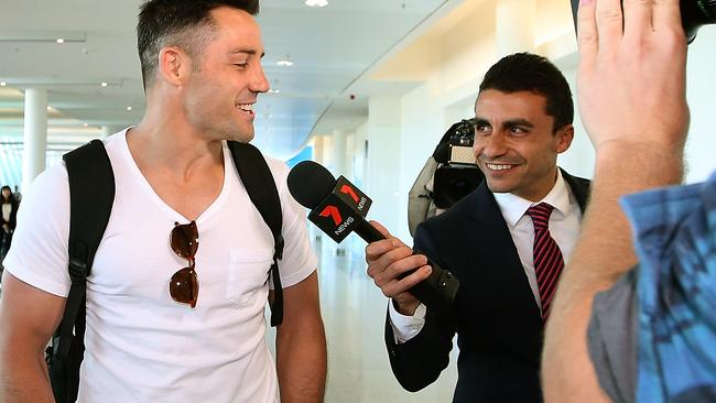 Cooper Cronk talks to media agt Canberra airport after signing with the Roosters.