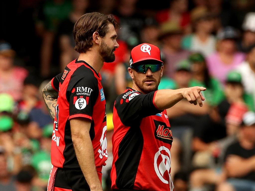 Aaron Finch and Kane Richardson of the Renegades work out their field placings during the Big Bash League (BBL) match final between the Melbourne Renegades and the Melbourne Stars at Marvel Stadium in Melbourne, Sunday, February 17, 2019. (AAP Image/Mark Dadswell) NO ARCHIVING, EDITORIAL USE ONLY