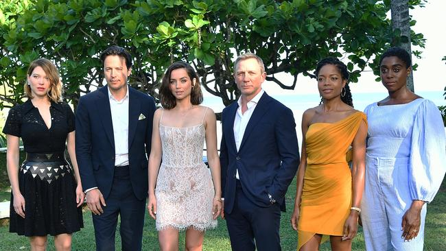 The cast of No Time To Die, l-r Lea Seydoux, director Cary Joji Fukunaga, Ana de Armas, Daniel Craig, Naomie Harris and Lashana Lynch in Jamaica last year at the start of filming. Picture: Slaven Vlasic/Getty Images for Metro Goldwyn Mayer Pictures