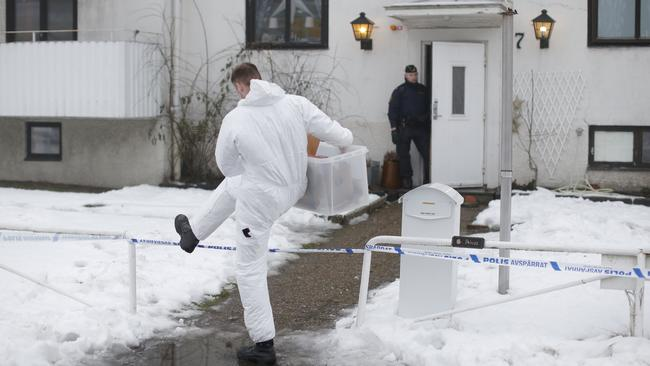 A forensic police officer carries a box of evidence following a search in front of a migrant center in Molndal outside Goteborg, Sweden on Monday. (Adam Ihse/ AP Photo)