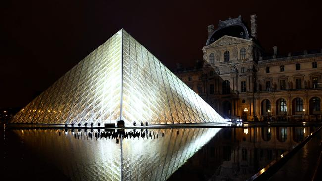 The show was staged at the Louvre Pyramid. Picture: AFP