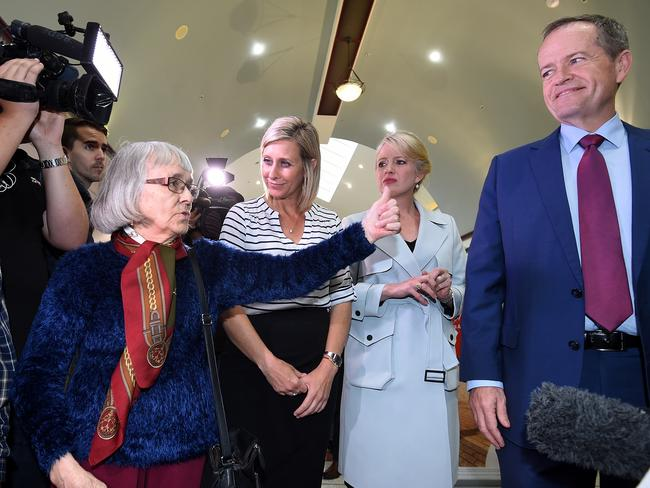 An elderly woman gives Bill Shorten the thumbs up during a visit to Morayfield, north of Brisbane on Tuesday. Picture: Dan Peled