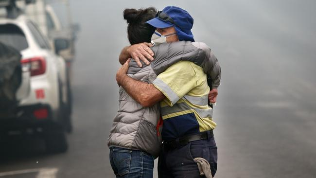 Cobargo resident Shona Taranto is comforted by Tim O'Mearo. Picture: Gary Ramage