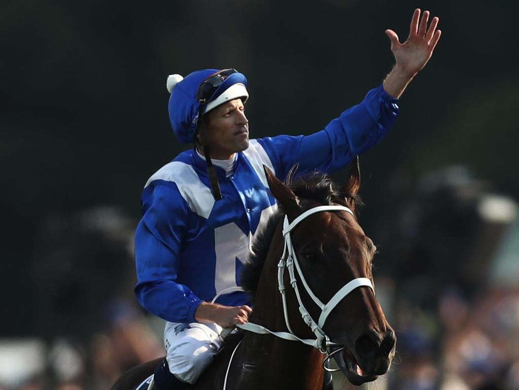 Hugh Bowman riding Winx celebrates as he returns to scale after winning the Longines Queen Elizabeth Stakes during The Championships Day 2 at Royal Randwick Racecourse on April 13, 2019