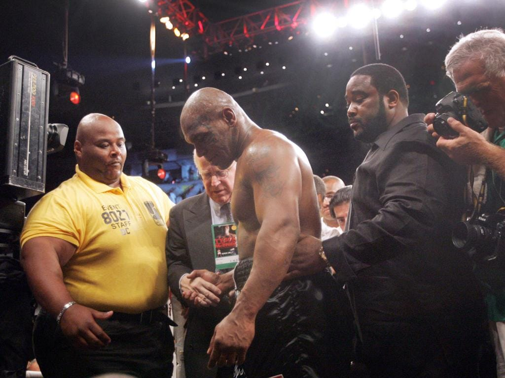 Mike Tyson exits the ring after losing to /Kevin /McBride in their heavyweight bout, Jun 11 2005 at the MCI Center iin Washington. (AP PicSusan/Walsh) sport boxing o/seas action