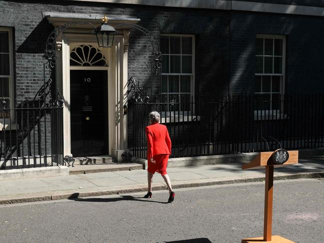 Mrs May's voice cracked as she left the lectern visibly emotional following her announcement. Picture: AFP