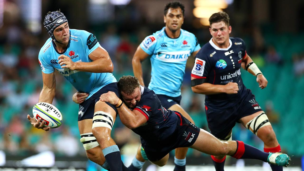 Rob Simmons of the Waratahs passes at the Sydney Cricket Ground.