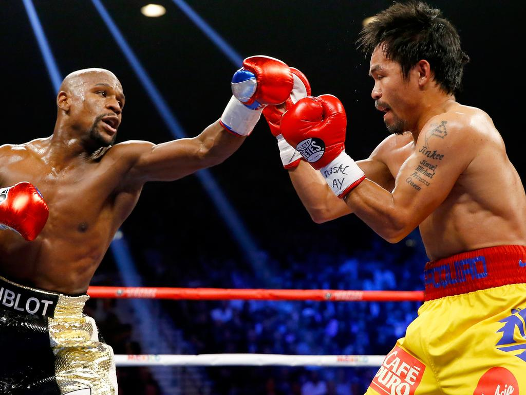LAS VEGAS, NV - MAY 02: Floyd Mayweather Jr. throws a left at Manny Pacquiao during their welterweight unification championship bout on May 2, 2015 at MGM Grand Garden Arena in Las Vegas, Nevada. (Photo by Al Bello/Getty Images)