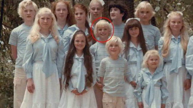 Mr Shenton (circled) as a child, dressed in matching outfits with his brothers and sisters.