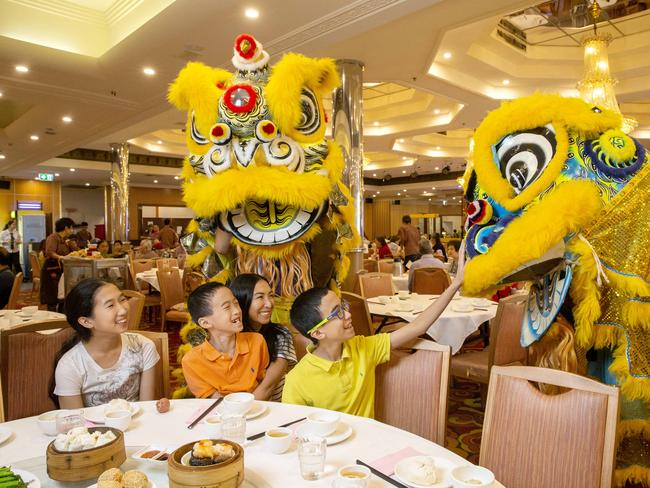 Angelica Ly-Liu, Isaac Ly-Liu, Claire Liu and Alexavier Ly-Liu are anticipating Chinese New Year at Sunnybank Plaza shopping centre. Picture: Richard Walker/AAP