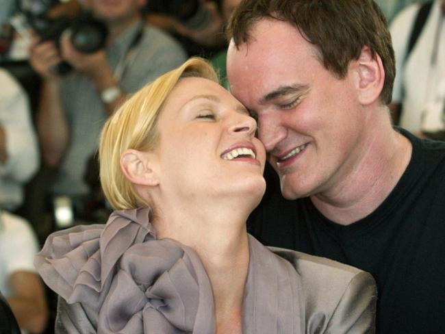 American film director Quentin Tarantino shares a light moment with actor Uma Thurman during a photo call for their film Kill Bill in 2004.