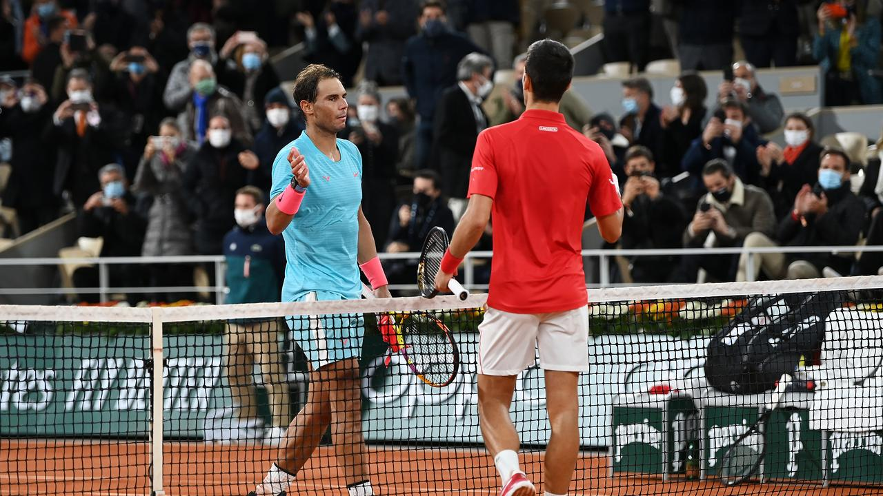Rafael Nadal shakes hands with Novak Djokovic after the straight sets victory.