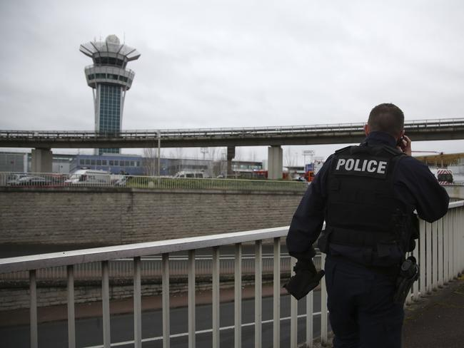 A police officer patrols at the Orly Airport, with its control tower in background, south of Paris. Picture: AP