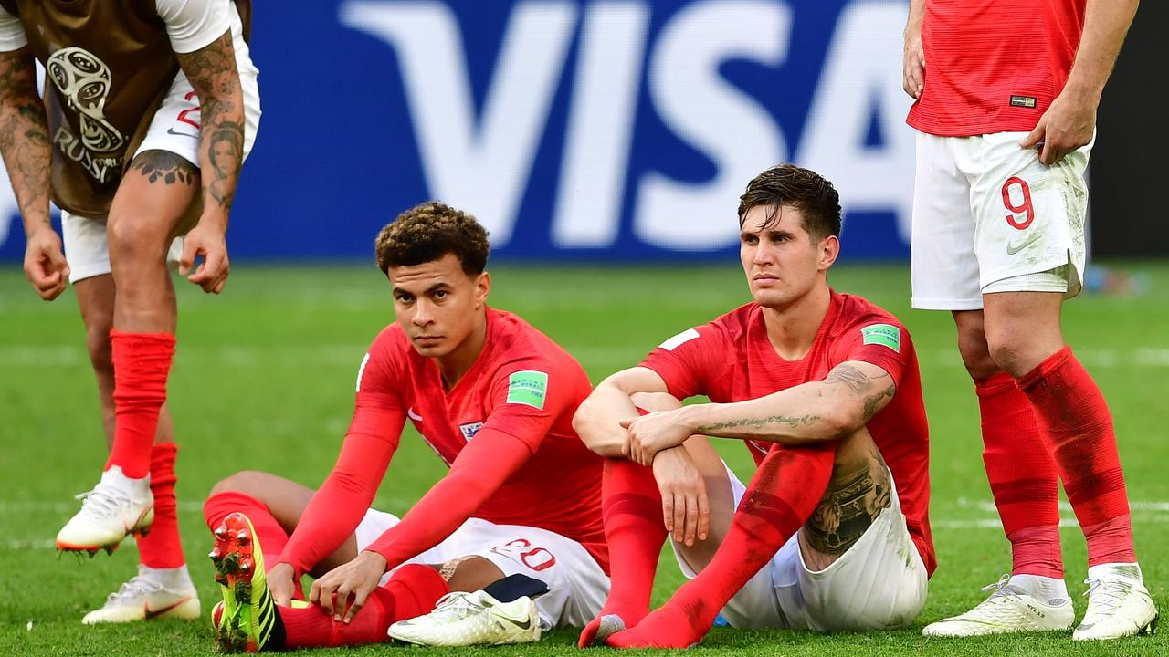 England's players look dejected after their 2-0 loss to Belgium.