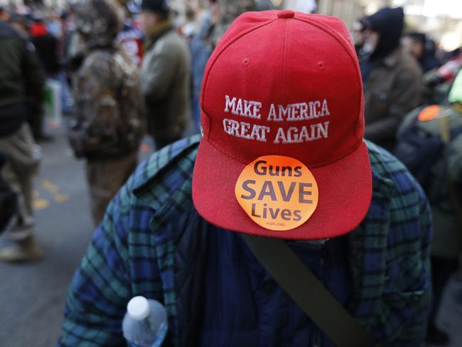 A man walks in the crowd during a pro-gun rally, wearing pro-Trump gear. Picture: AP Photo/Julio Cortez