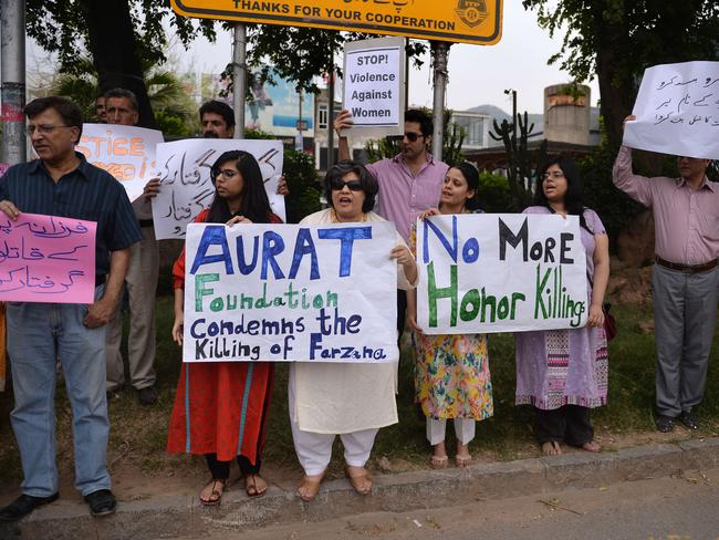 Outrage ... Pakistani human rights activists hold placards as they chant slogans during a protest in Islamabad against the killing of Parveen.