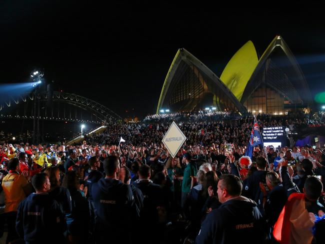 Australian athletes enter the forecourt of the Sydney Opera House for the opening ceremony. Picture: Toby Zerna