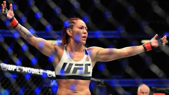 Cris Cyborg after claiming the UFC featherweight title.