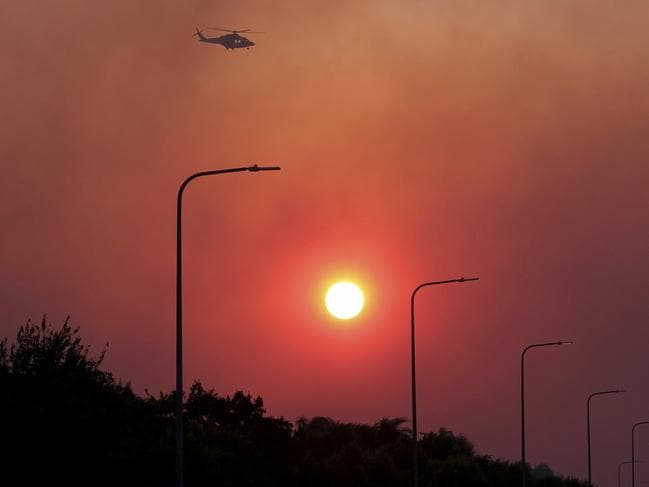 The sun rises through thick smoke from the fires near Los Angeles in which two have died. Picture: Dean Musgrove/The Orange County Register.