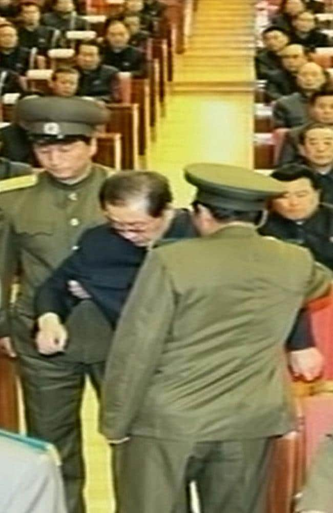 This grab taken from footage shown by North Korea's KCTV shows Jang Song-Thaek being dragged out from his chair by two police officials during a meeting in Pyongyang. North Korea confirmed that the powerful uncle of young leader Kim Jong-un had been purged.