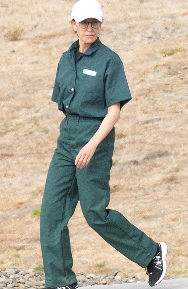 First pictures of convicted felon, Felicity Huffman seen wearing a prison jumpsuit while serving out her sentence on federal charges. Picture: SplashNews.com