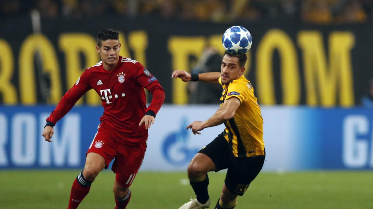 AEK's Vasileios Lampropoulos, right, vies for the ball with Bayern midfielder James Rodriguez