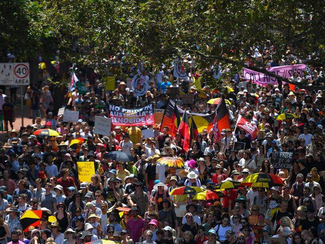Protesters march down Pitt Street in Sydney on Sunday, January 26, 2020. Picture: Paul Braven