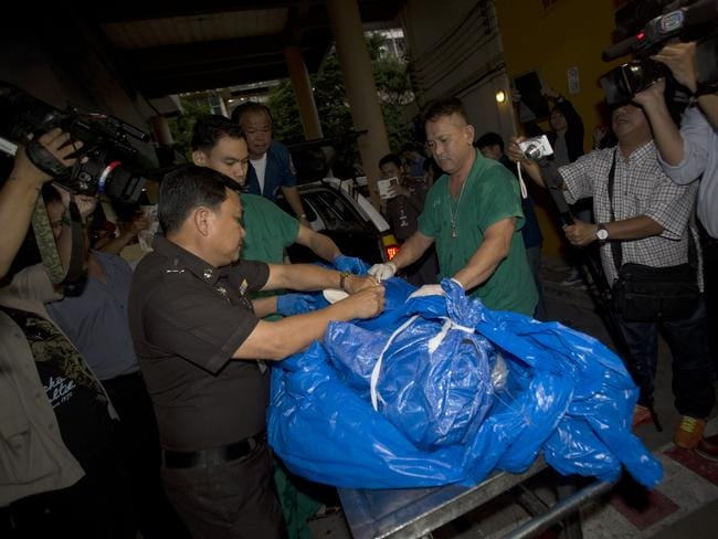 The body of slain British tourist David Miller, wrapped in plastic sheet, at a forensic police facility in Bangkok in September 2014. Picture: Sakchai Lalit