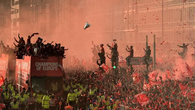 Fans in Liverpool celebrate as Liverpool players parade the European Cup following last season's Champions League win. Picture: AFP